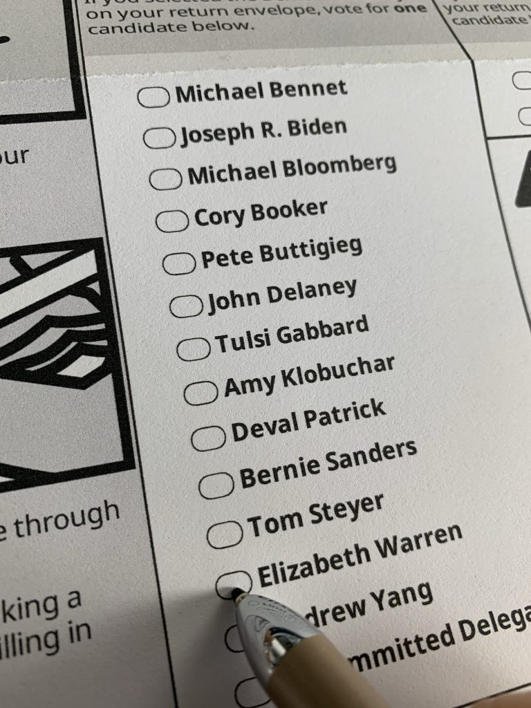 A pen rests on the bubble next to Elizabeth Warren on a ballot